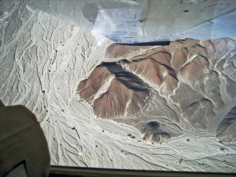 Flying over the Nazca Lines - Viewing Spaceman on side of the Mountain